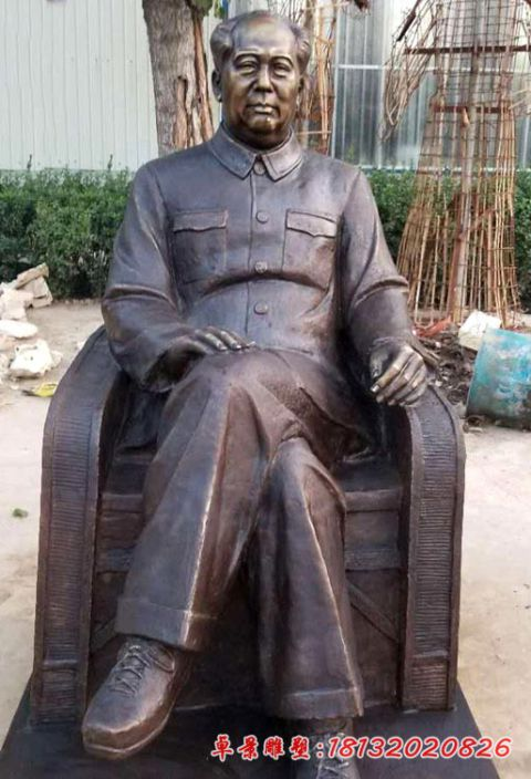 Chairman Mao sitting in a chair